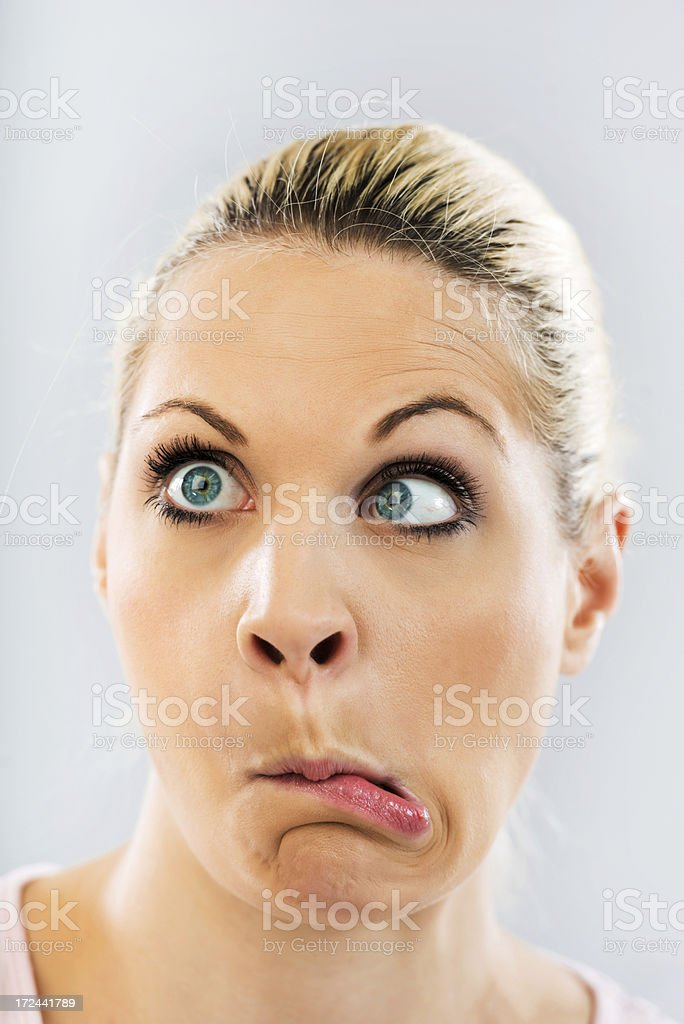 Grimacing young woman. royalty-free stock photo