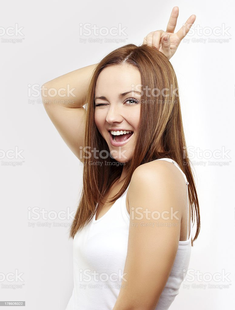 Grimacing.Excited woman doing hand sign royalty-free stock photo