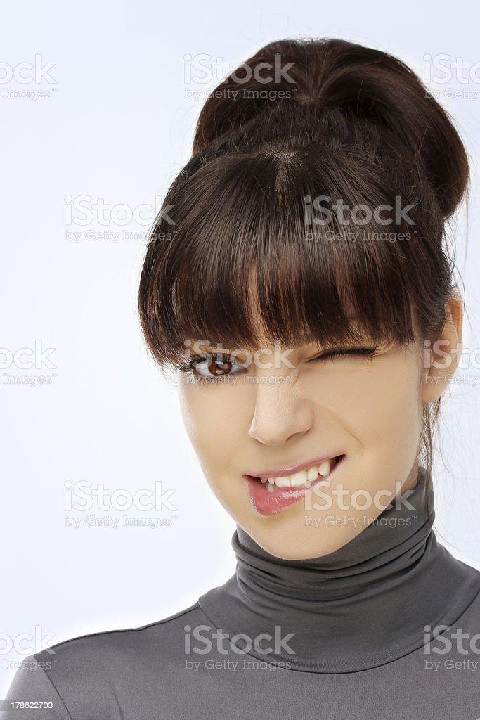 Grimacing.Winking woman royalty-free stock photo