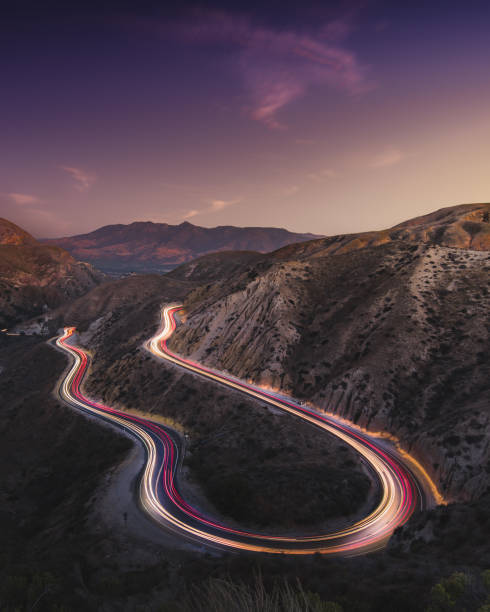 Grimes Canyon Long Exposure with car trails and milkyway Grimes Canyon near Los Angeles night photography long exposure stock pictures, royalty-free photos & images