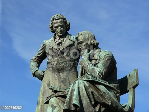 Grimm Brothers - Jacob and Wilhelm Grimm - famous literary national monument in Germany, designed and built by the sculptor Syrius Eberle. The bronze statue was erected 1896 and is situated on the marketplace in front of the town hall in Hanau city. The Grimm Brothers were among the first and best-known collectors of folk tales.