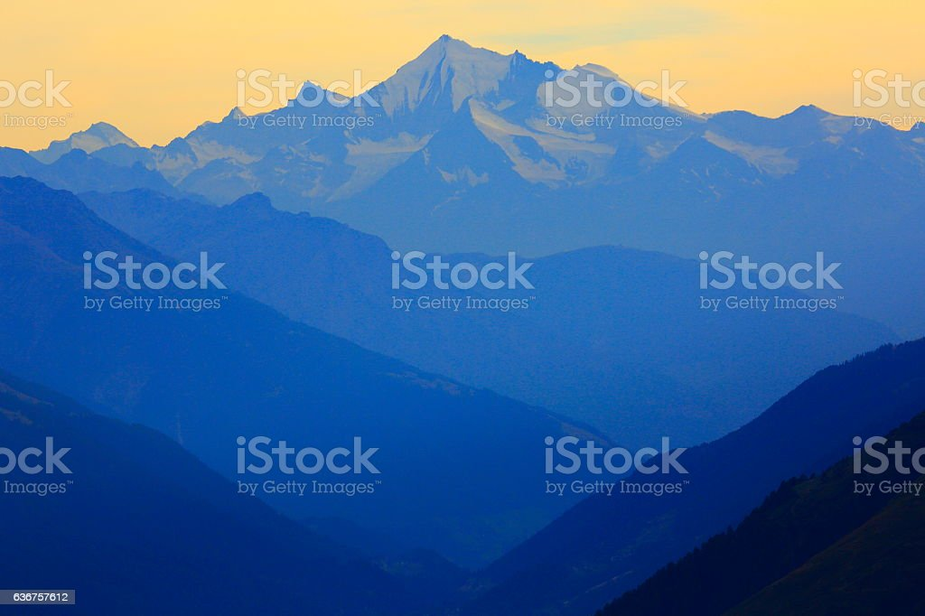 Grimsel and Furka mountain range silhouette dawn, Swiss Bernese Alps stock photo