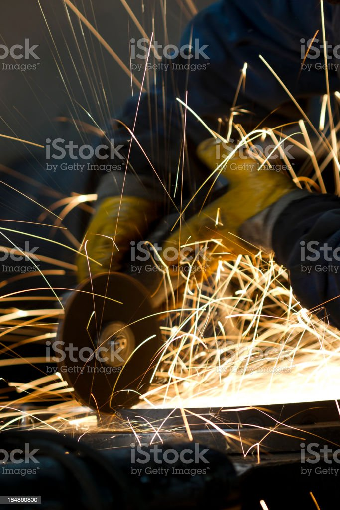 Grinder throwing sparks royalty-free stock photo