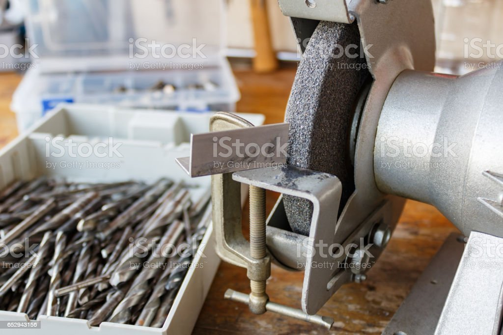 Grinding machine and a set of drill bits for sharpening stock photo