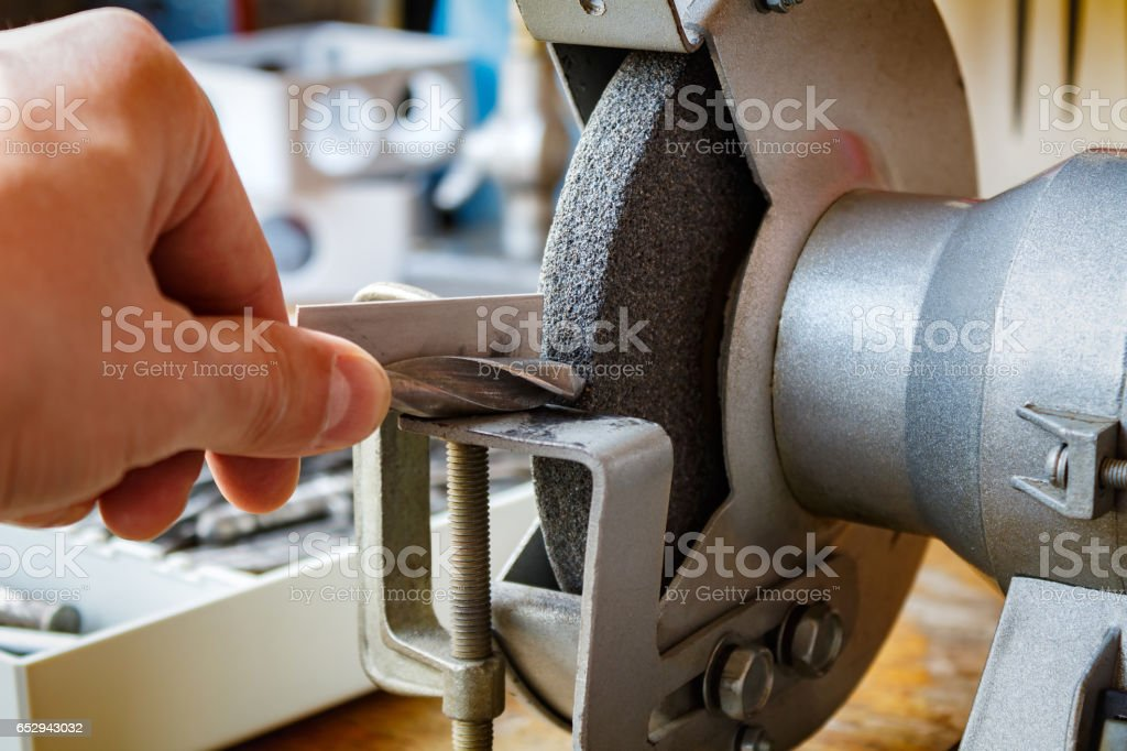 Grinding machine for the sharpening of drills stock photo