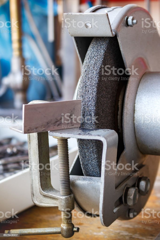 Grinding machine in the workshop for tool sharpening stock photo