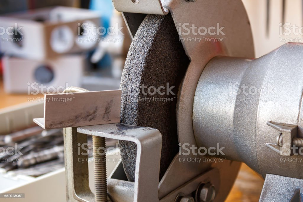 Grinding machine on the table in the workshop closeup stock photo