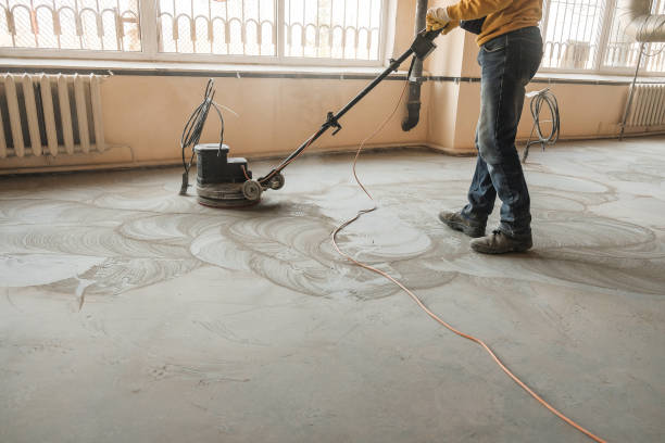 grinding of concrete floor workers grind the concrete floor at the construction site grinding stock pictures, royalty-free photos & images
