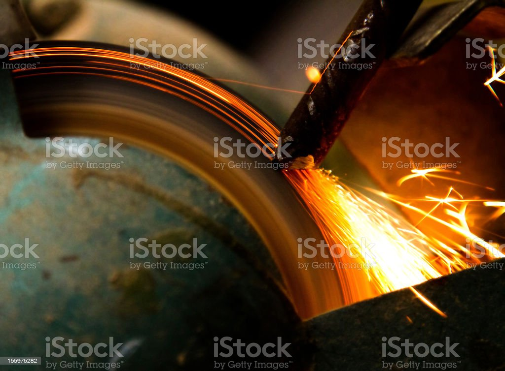 Grinding or sharpening metal stock photo