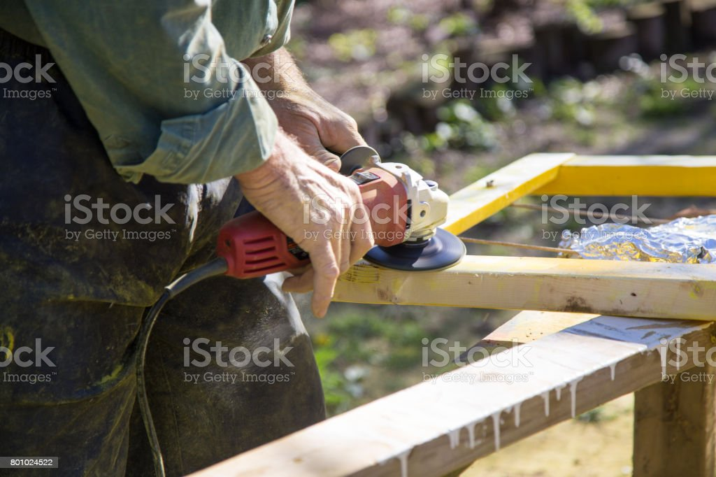 grinding paint from a wood frame stock photo