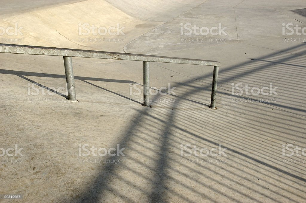 Grinding rail at a skatepark stock photo