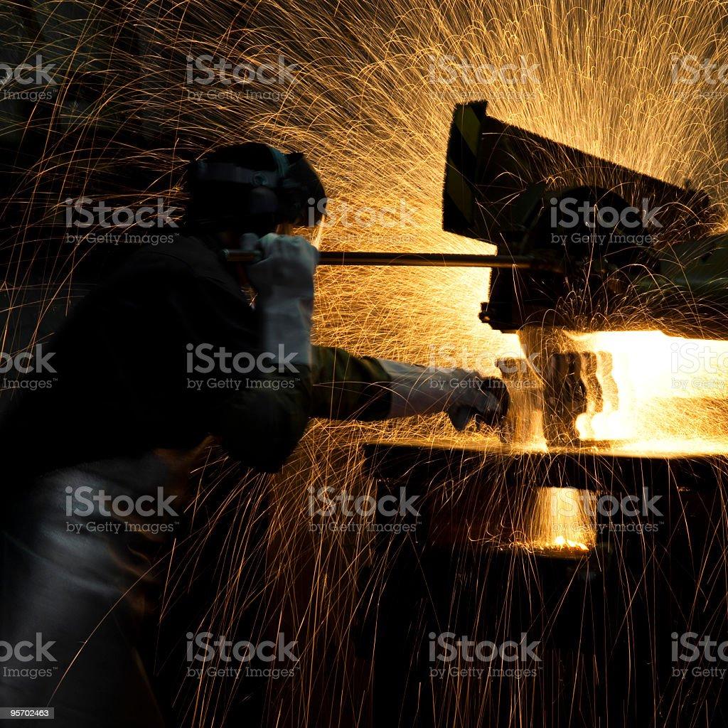 grinding steel worker royalty-free stock photo
