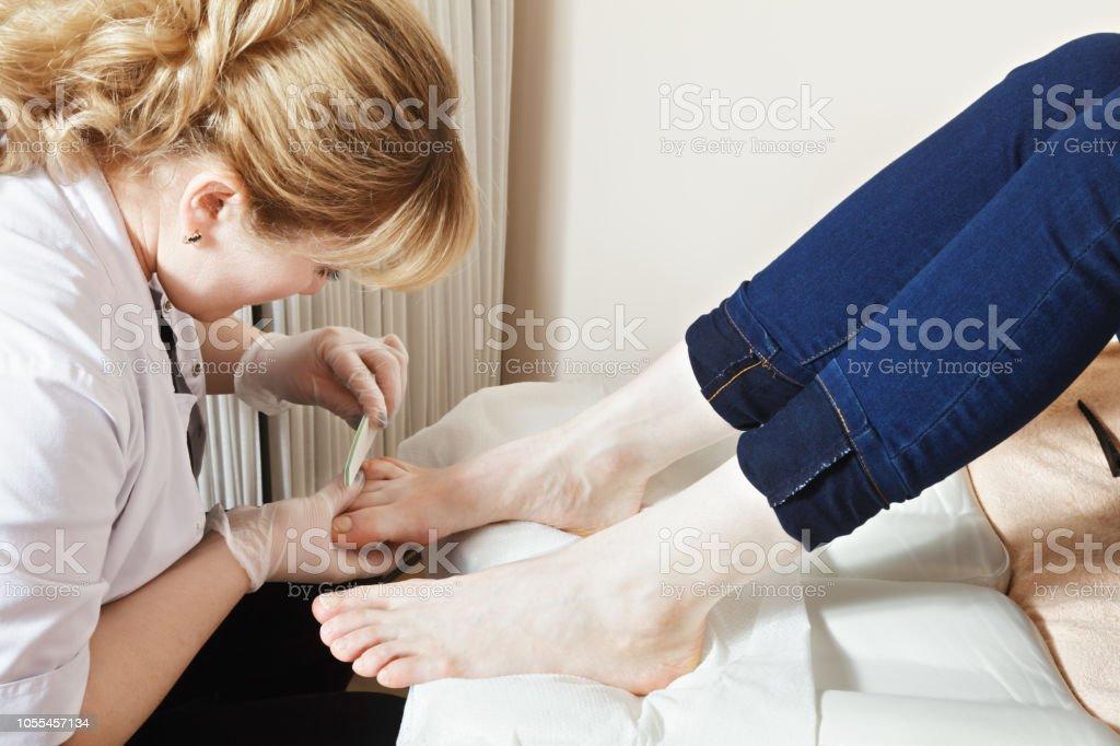 Grinding toenails process stock photo