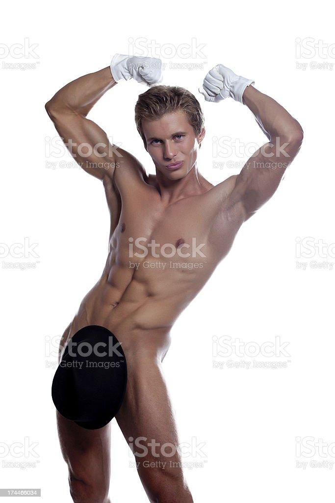Grinning handsome stripteaser posing in studio stock photo
