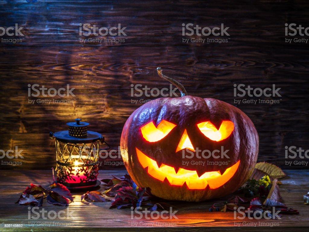 Grinning pumpkin lantern or jack-o'-lantern is one of the symbols of Halloween. Halloween attribute. stock photo