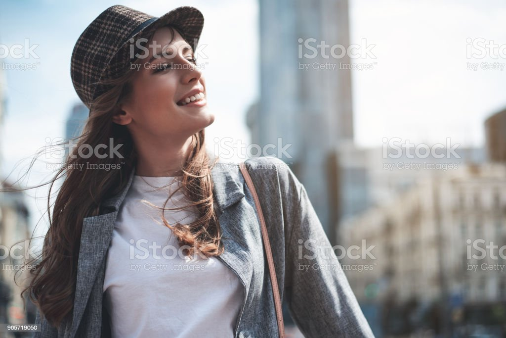 Grinning woman is relaxing outdoors - Royalty-free Adult Stock Photo