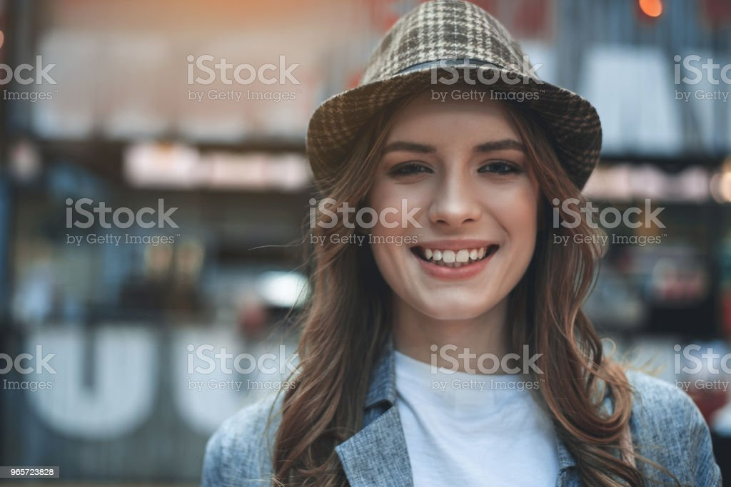Grinning young lady in trendy hat - Royalty-free Adult Stock Photo