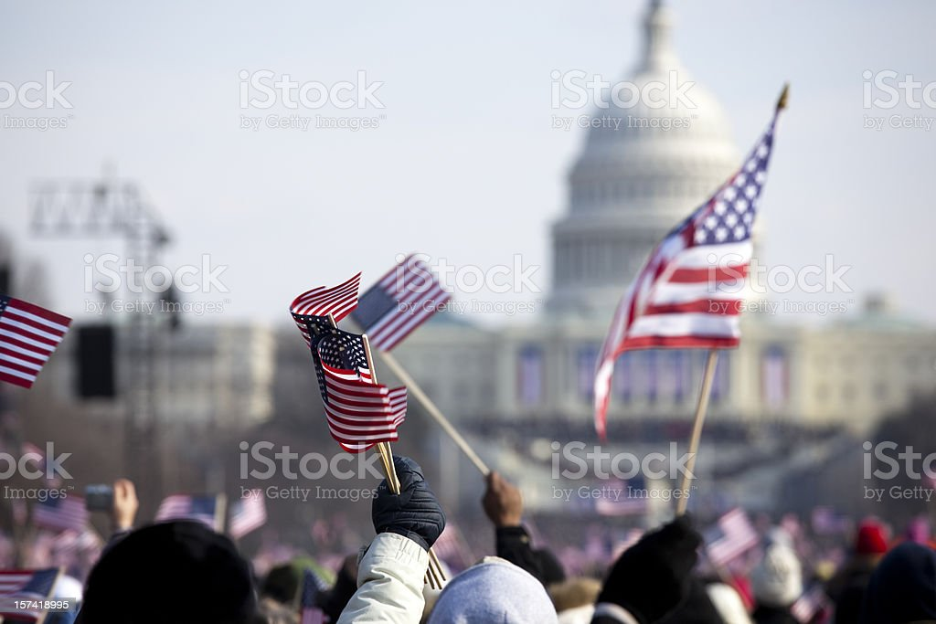 A grip of people holding flags in front of the White House stock photo
