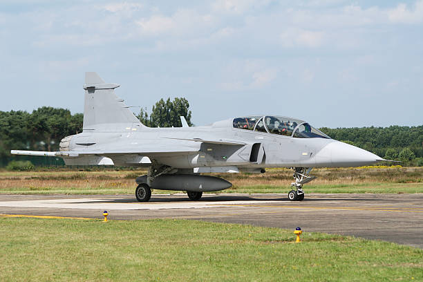 SAAB Gripen jet fighter Saab Gripen taxiing off the runway of a European airbase saab stock pictures, royalty-free photos & images