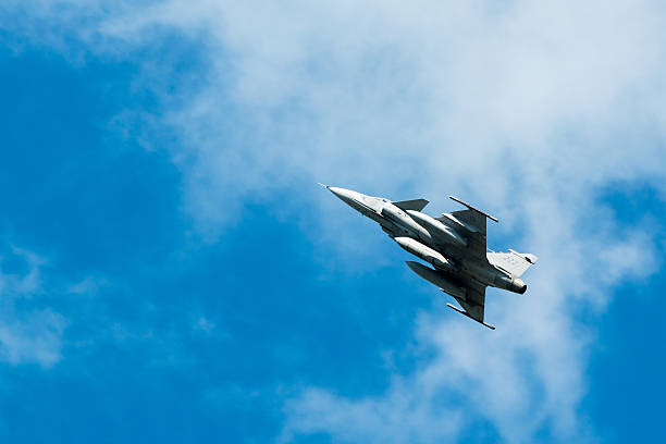 SAAB JAS 39 Gripen Kallinge, Sweden - June 01, 2014: Swedish Air Force air show 2014 at F 17 Wing. SAAB JAS 39 Gripen in the air. saab stock pictures, royalty-free photos & images