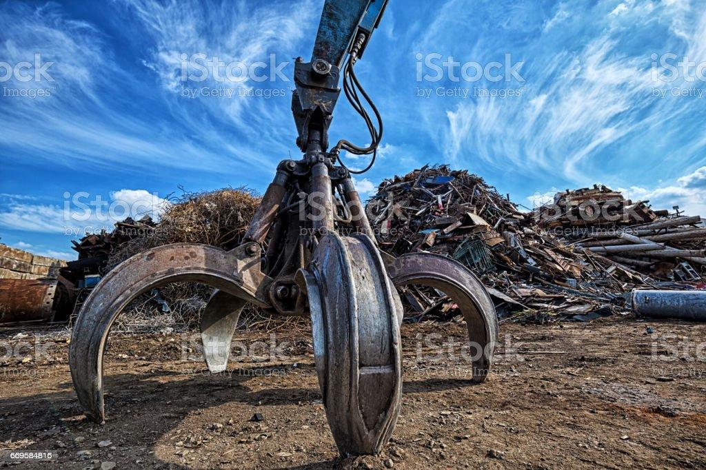 Gripper excavator on a scrap yard. HDR - high dynamic range stock photo