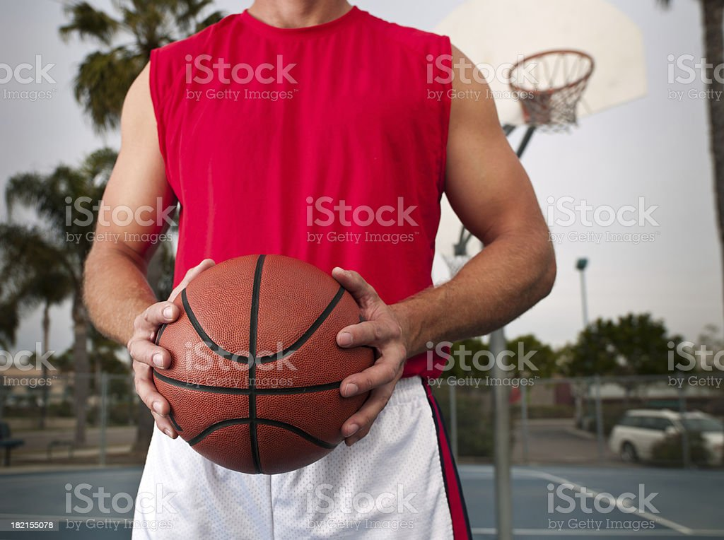 Gripping a Basketball royalty-free stock photo