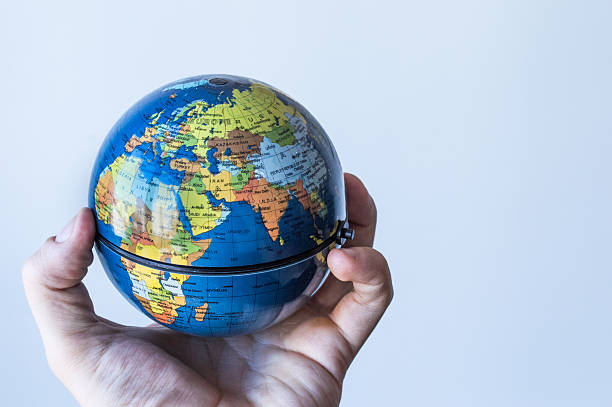 Gripping a Globe in Palm of Hand Europe/Africa stock photo