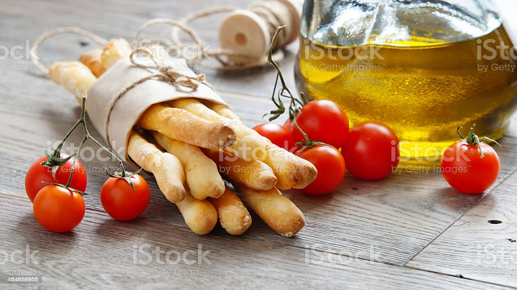 grissini, cherry tomatoes and olive oil stock photo