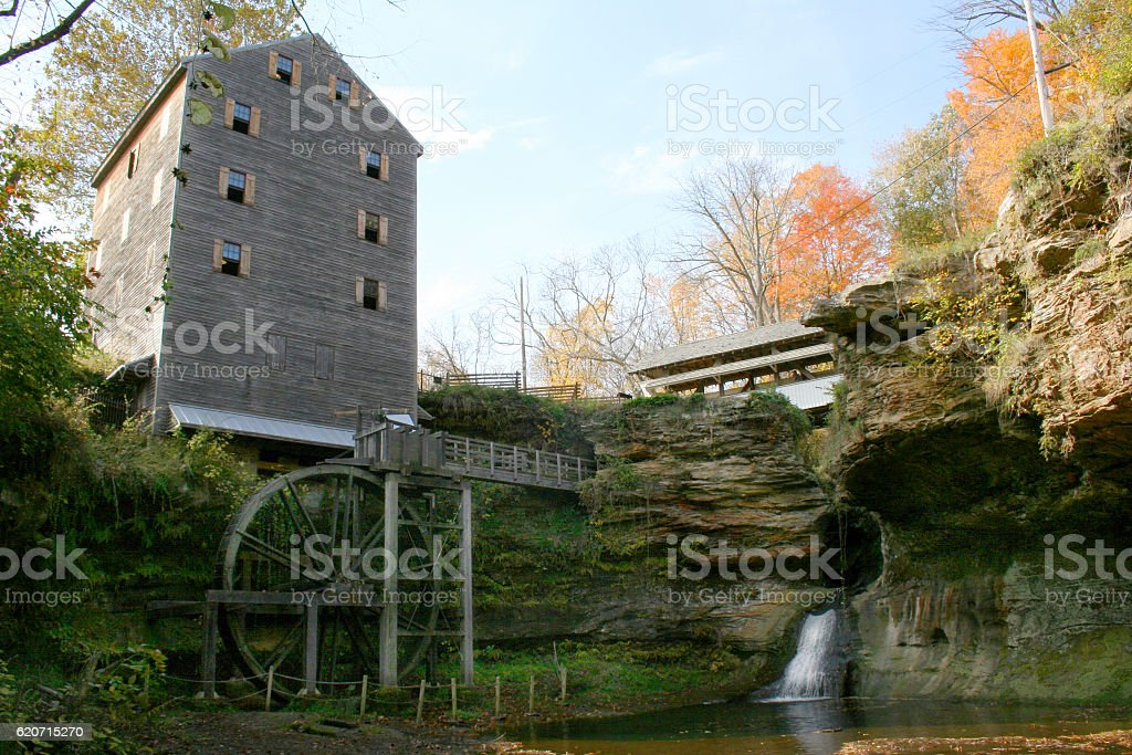 Grist Mill and Covered Bridge in Autum stock photo