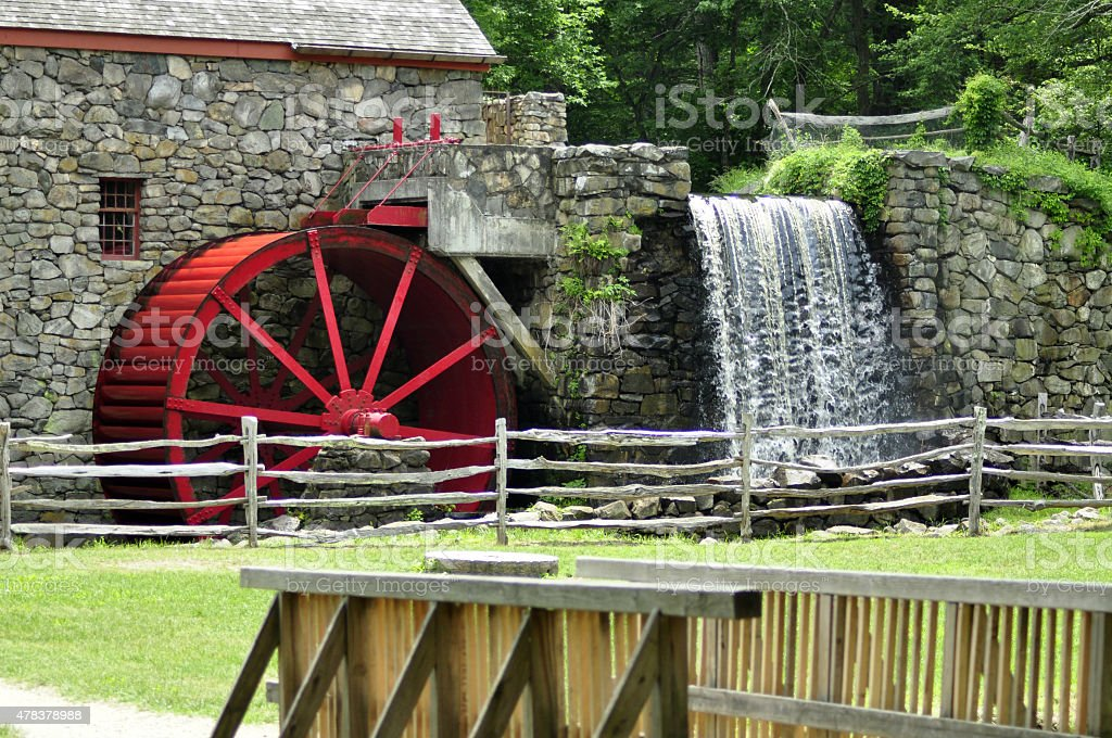 Gristmill and Waterfall with Wooden Bridge stock photo