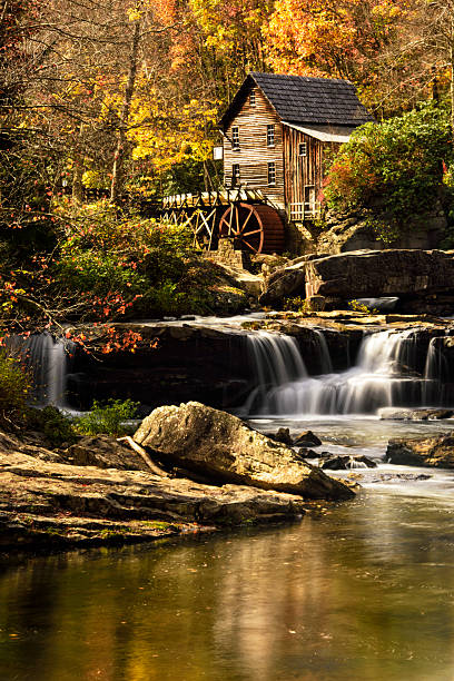 Gristmill in Full Autumn Peak Color Glade Creek Gristmill in Full Autumn Peak Color, Babcock State Park, West Virginia babcock state park stock pictures, royalty-free photos & images
