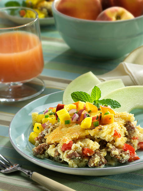 Grits and sausage casserole with peach salsa stock photo