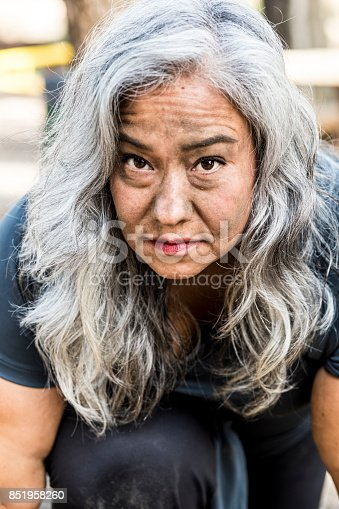 851958232 istock photo Gritty Senior Mexican Woman 851958260