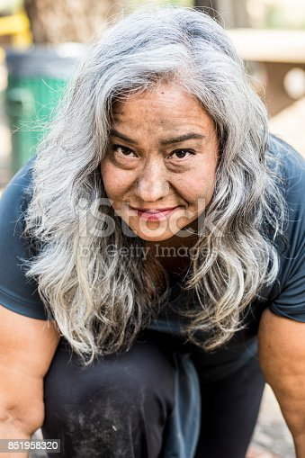 851958232 istock photo Gritty Senior Mexican Woman 851958320