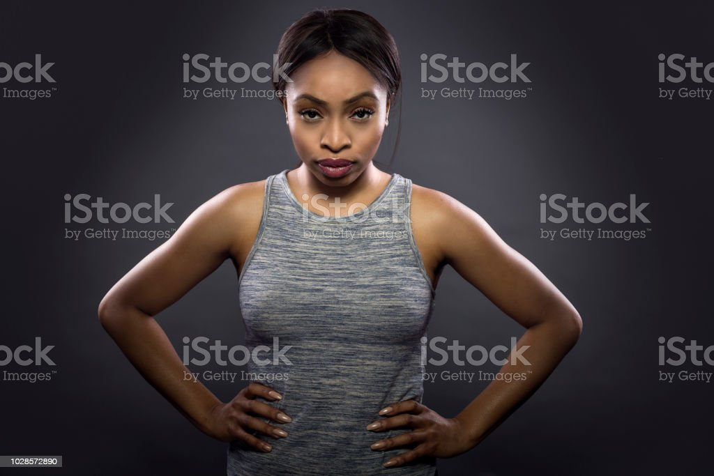 Gritty Woman Black Fitness Trainer stock photo