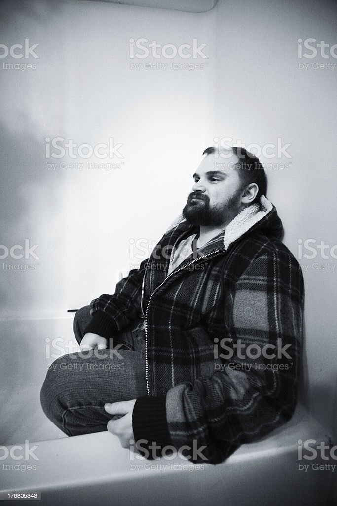 Grizzly Mountain Man in a Bathtub royalty-free stock photo