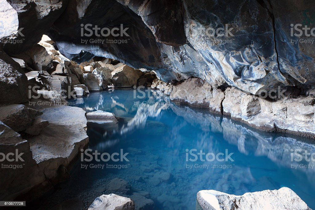 Grjotagja lava cave stock photo