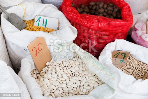 Groats, beans and nuts in bags on the farmer's market.