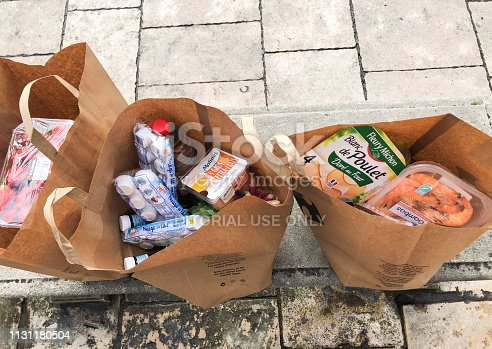 Bordeaux, France - April 30, 2018: Groceries bags from local supermarket on Bordeaux sidewalk, France