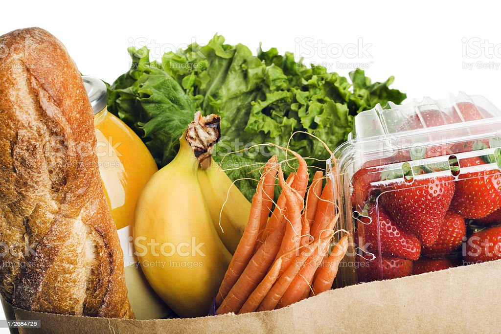 Groceries in Grocery Paper Bag with Healthy Fresh Food royalty-free stock photo