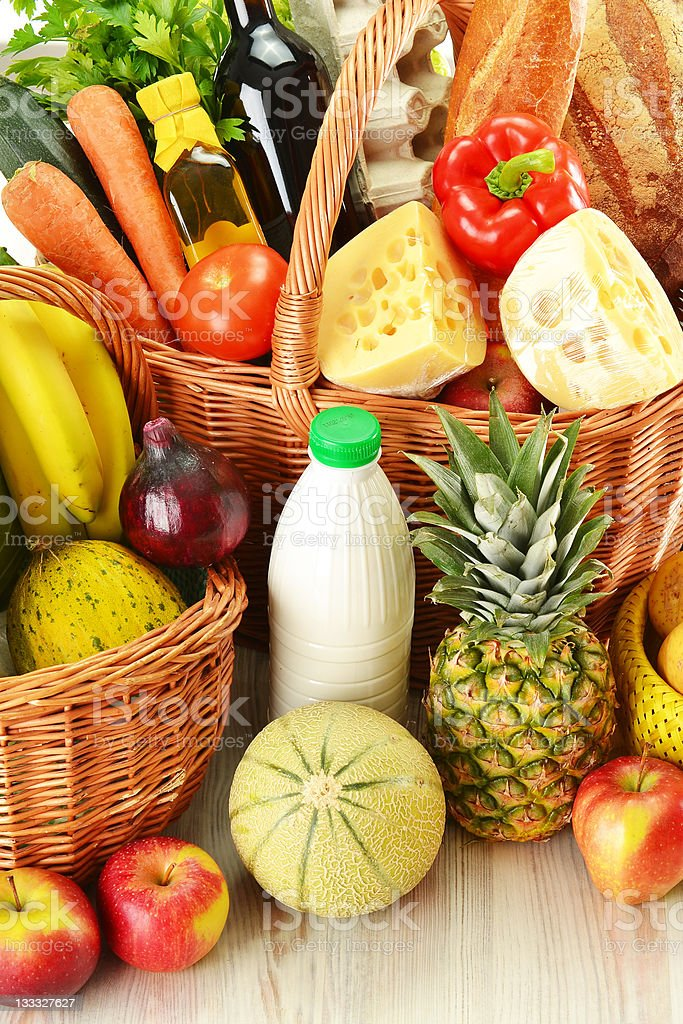 Groceries in wicker baskets royalty-free stock photo