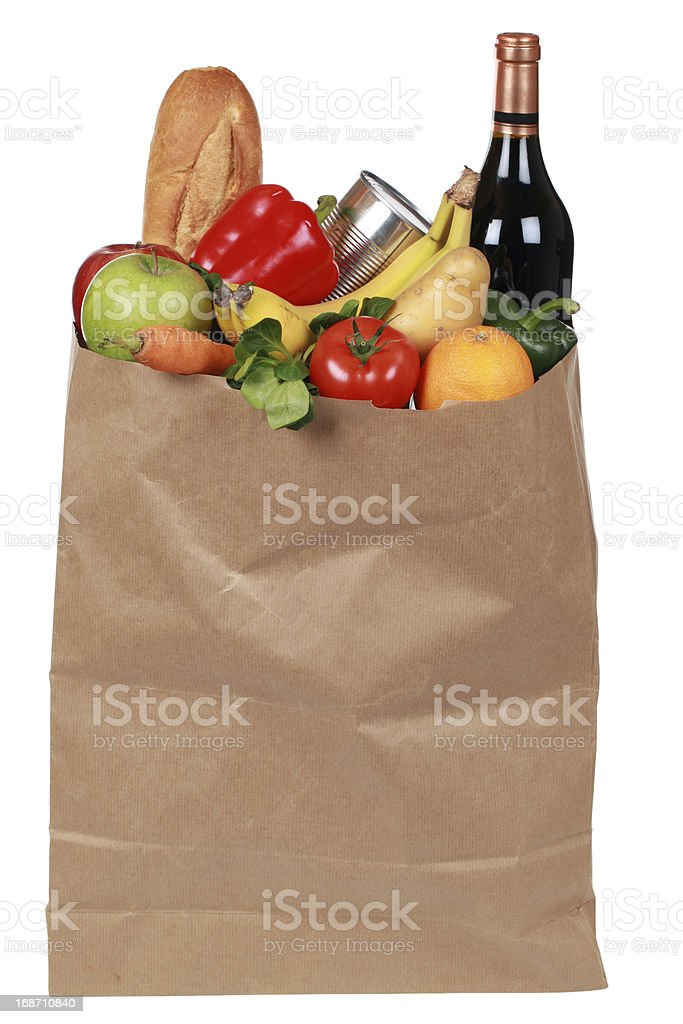 Groceries including fruits, vegetables and a wine bottle royalty-free stock photo