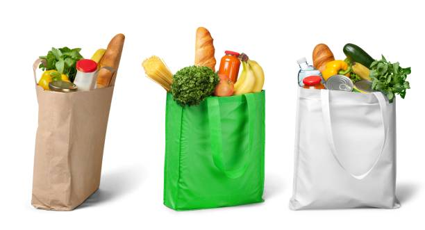 Groceries. Shopping bags with groceries on white bag stock pictures, royalty-free photos & images
