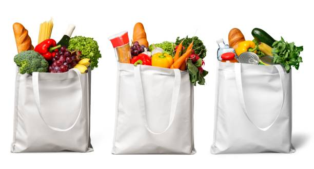 Groceries. Shopping bags with groceries isolated on white bag stock pictures, royalty-free photos & images