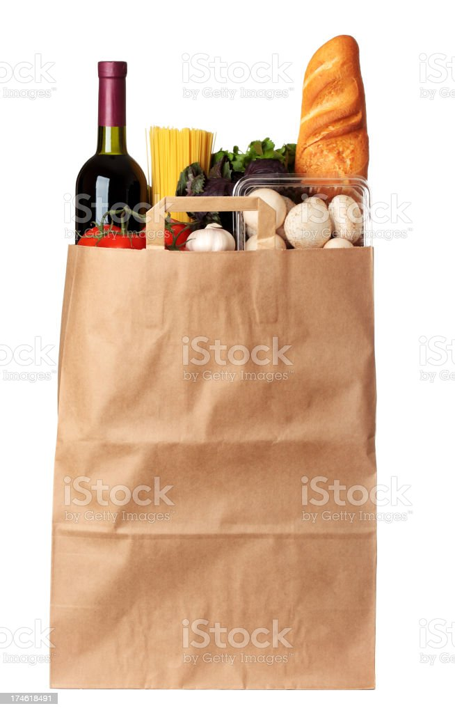 Groceries stuffed in brown paper bag royalty-free stock photo