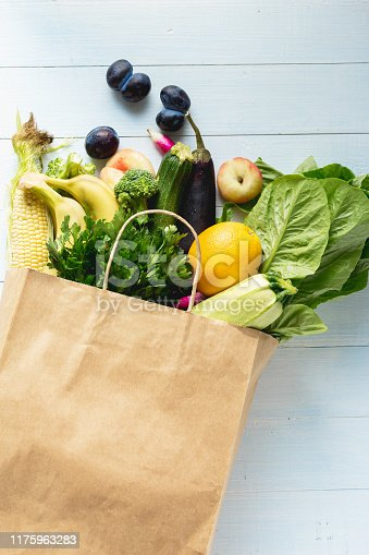 1126188273 istock photo Grocery bag with vegetables and fruits 1175963283