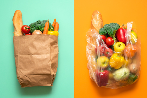 Grocery bags, paper versus plastic. Plastic-free shopping concept