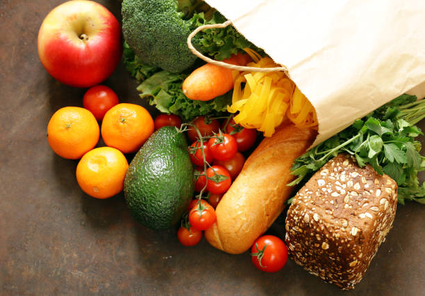 Grocery food shopping bag - vegetables, fruits, bread and pasta stock photo