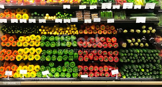 A colorful display of fresh vegetables in a grocery market store.