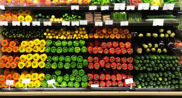 Grocery Market Store Display of Fresh Produce Vegetable in Refrigerator Case A colorful display of fresh vegetables in a grocery market store. produce aisle stock pictures, royalty-free photos & images